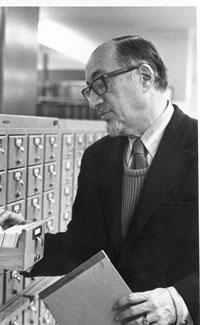 Eli M. Oboler using the card catalog